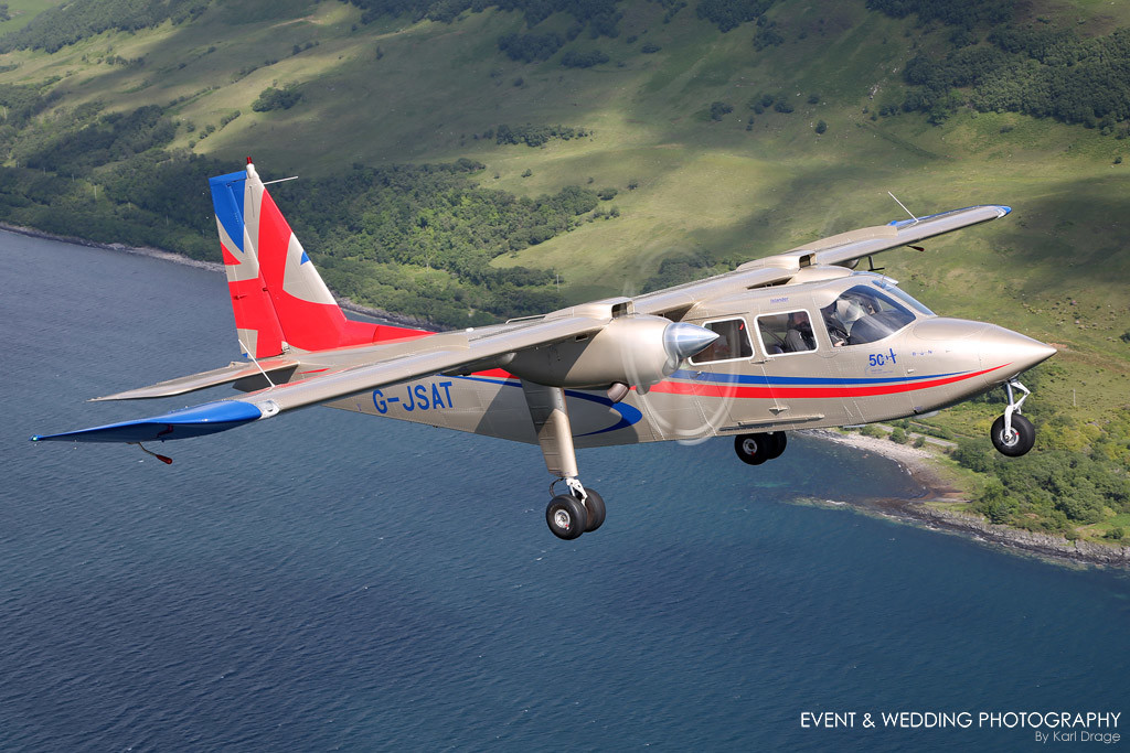 A Britten-Norman Islander is pictured over a Scottish loch - by Northamptonshire photographer Karl Drage