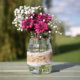 Beautiful flowers in a hand-decorated jar.