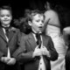 Pageboys outside the church.