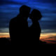 A wedding day kiss after sunset on Halloween.