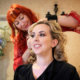 A hair stylist secures the Bride's hair on her wedding day.