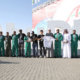Members of Al Ain Football Club join with the Saudi Hawks display team at Al Ain Air Championships.