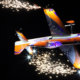 A remote-controlled plane, fitted with pyrotechnics on the ends of its wings, performs at Weston Park In The Dark.