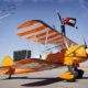 The UAE display team, Fursan Al Emarat, fly over the top of a Boeing Stearman during a press-launch for the Al Ain Air Championships.