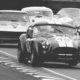 Cars race around the track at the Goodwood Revival.